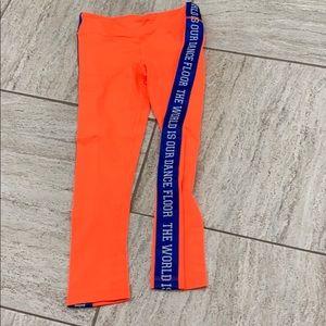Electric orange zumba pants w/ blue side stripe.